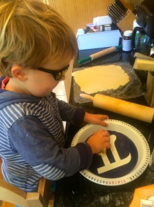 """Buttering the """"Pi"""" dish."""
